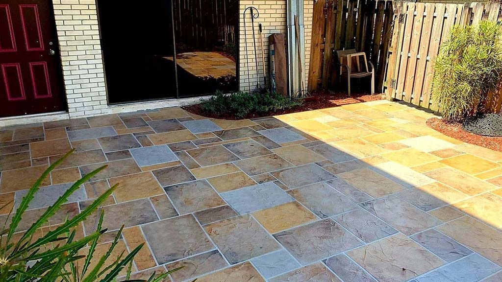 concrete patio resurfacing in earth and gray tones geometric shapes