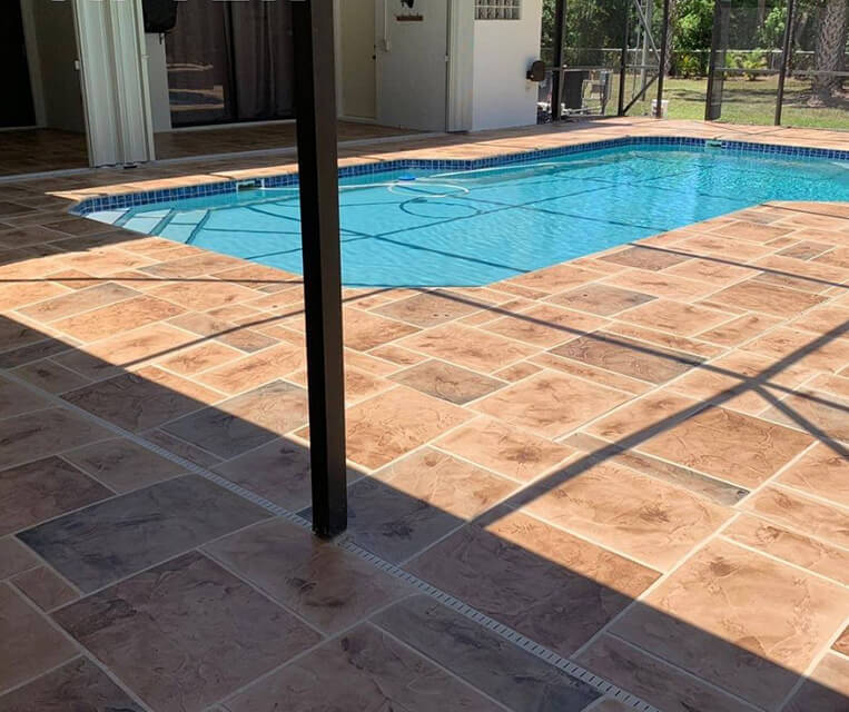 pool deck and patio concrete overlay in terracotta color
