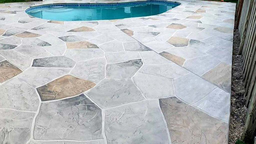 pool deck concrete overlay in earth tones stone pattern